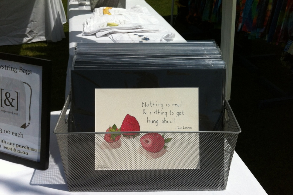One of the original functions of [&] was to sell Becca's art and things we make from it, like in this festival booth in 2015.