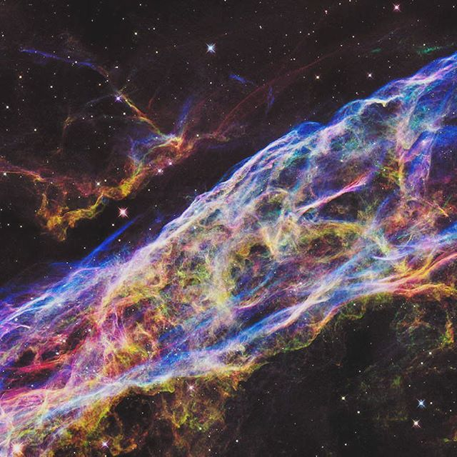 Hubble image of The Veil Nebula.  The blue gases are hotter than reds and greens.  A nebula is a system of gas clouds and dust that can compress with gravity forming stars when hydrogen combines to make helium.  Basically this is an image of birth in the universe.  Its where we all come from.  #digthescience
