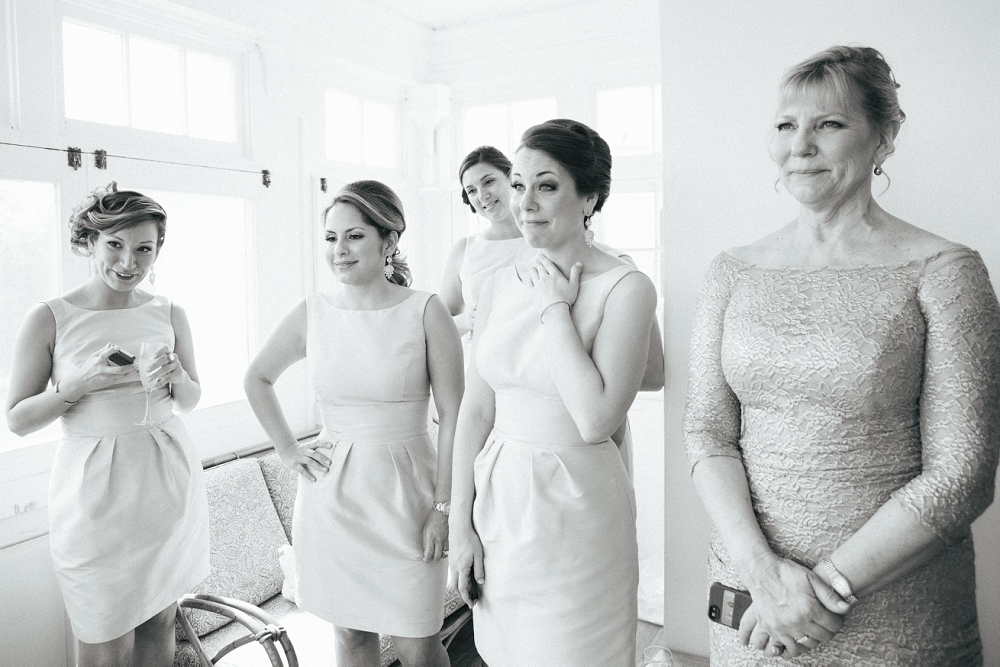 09 Bridesmaids Reaction to Bride in Dress.JPG