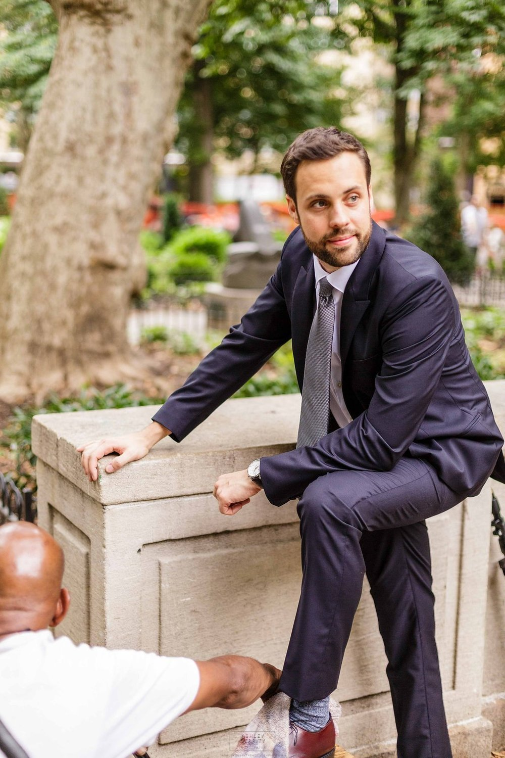 07 Philadelphia Wedding Stotesbury Mansion Rittenhouse Square Groom Shoeshine.jpg