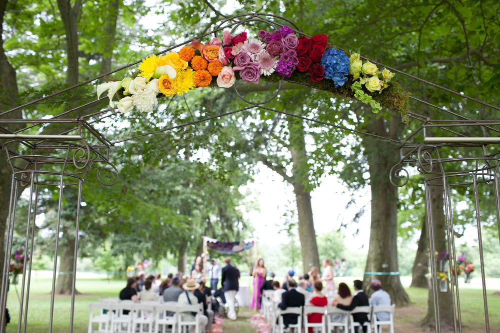 61 Rainbow Flower Arch Outdoor Ceremony Chester County Wedding Florist.jpg