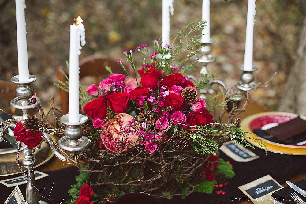 58 Woodland centerpiece pomegranate pinecone red rose candelabra branches.jpg