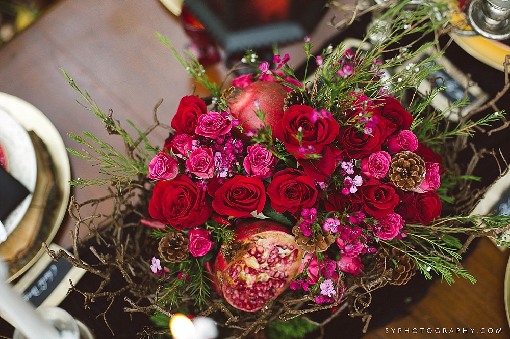 59 Red Rose Branches Pinecones Pomegranate Centerpiece Exton Wedding Florist.jpg