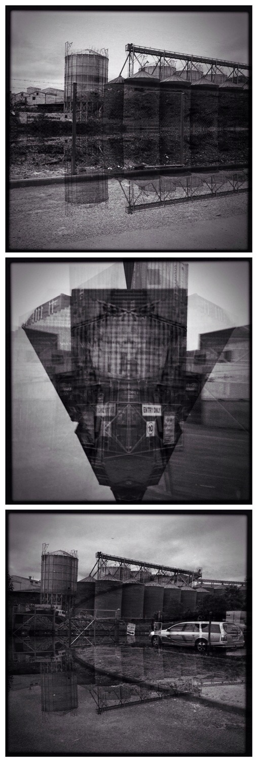 Black and white photos of silos and industrial buildings creating surreal reflected symmetry and flooded landscapes.