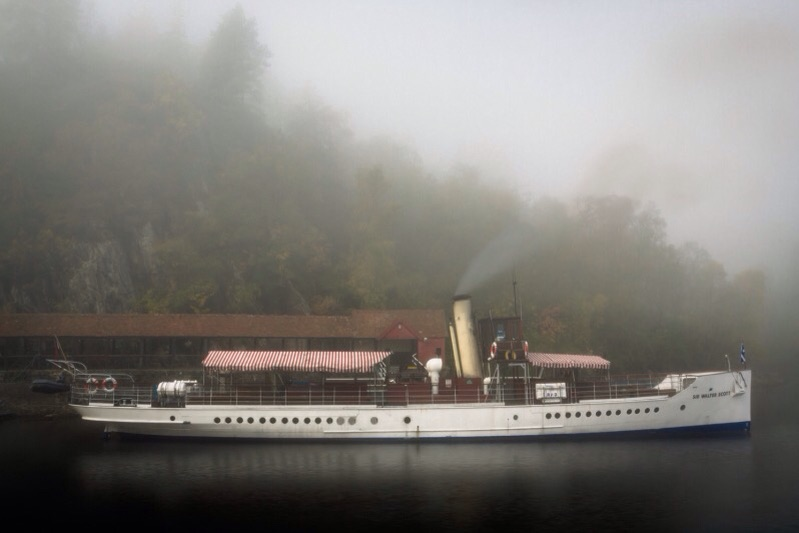 The SS Walter Scott at her berth in heavy fog on Loch Katrine, Scotland
