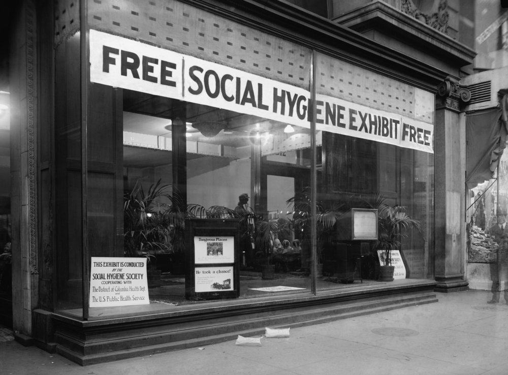 photo: Social Hygiene Society storefront in Washington, D.C in 1922. The Progressive-era movement sought to control venereal disease, regulate prostitution and vice, and disseminate sexual education. credit: Everett Historical