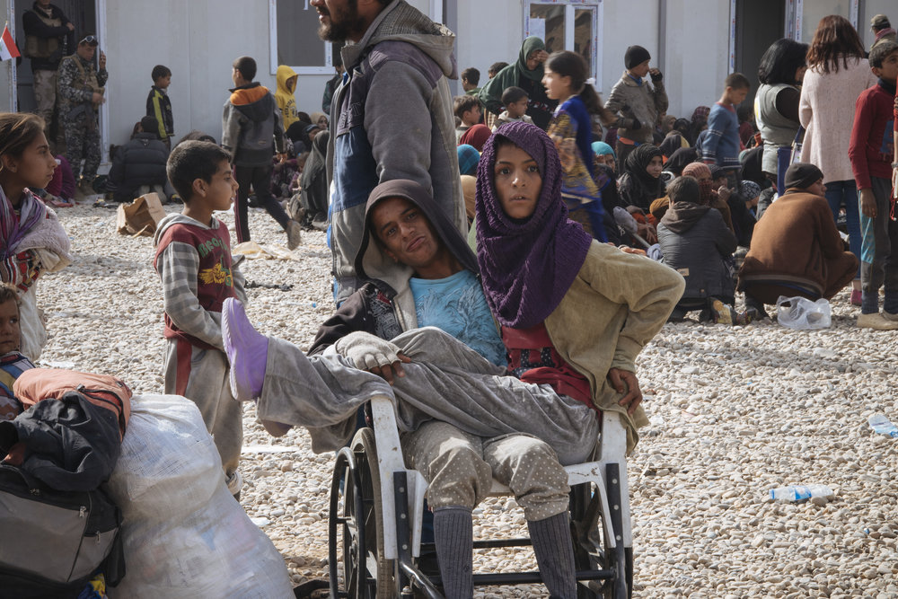 Two siblings in a displace camp, both were unable to walk and had to share a wheelchair.