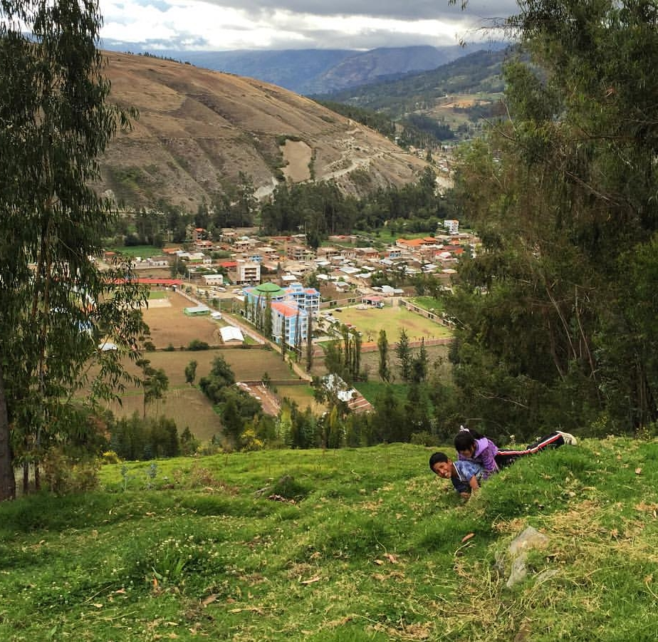 Little sister and Big brother from Casa Hogar Andahuaylas roll down their steep mountains overlooking the San Jeronimo valley.