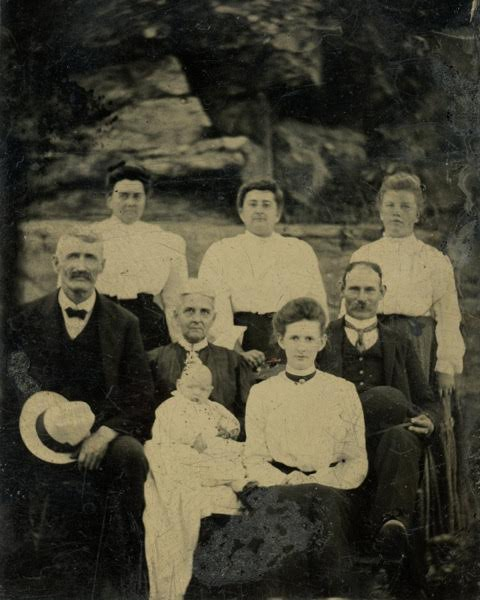 L to R back row : Lizzie Hopkins Harris, Susan E. Hopkins Harris, Harriet Hopkins (daughters of Susan & Ira Hopkins).  Front row:  Ira W. Hopkins, Susan D. (Harris) Hopkins, probably Howard Fenner Jr., Cora Wade (Harris) Fenner, Howard Fenner. Photo courtesy of Tammy Vincent.