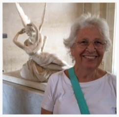 In the Louvre with a sculpture of Cupid and Psyche. August 2015