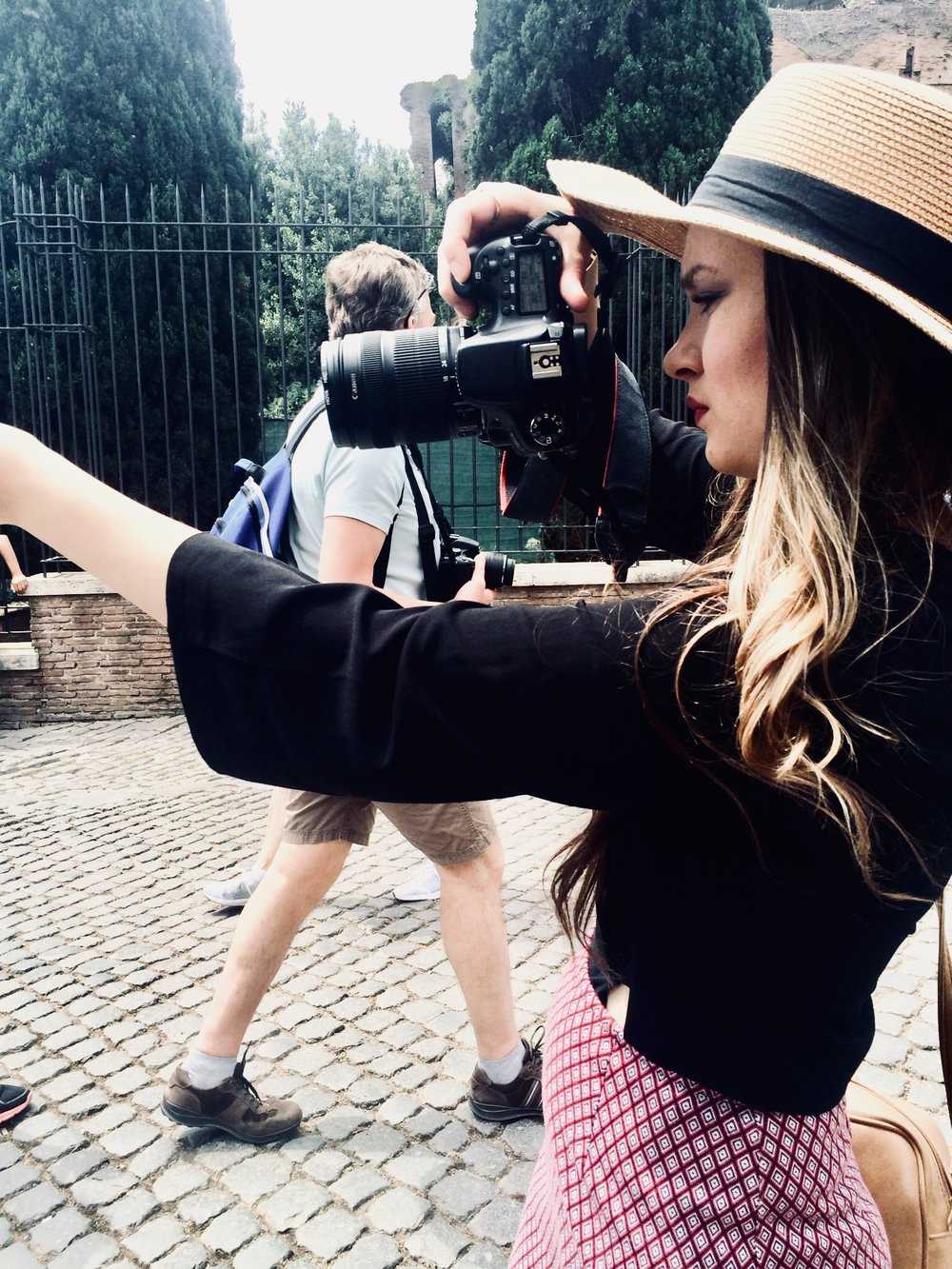 Me taking photos on one of my travels to Italia