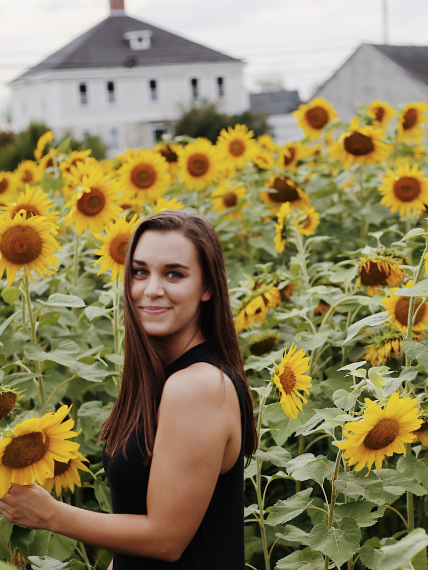 Jessica Meade amidst her favorite flower - Daisies!