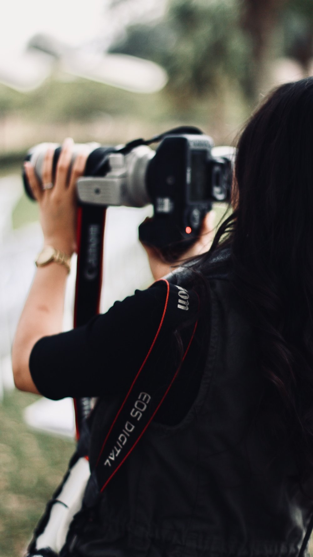 Christine Tran working as wedding photographer