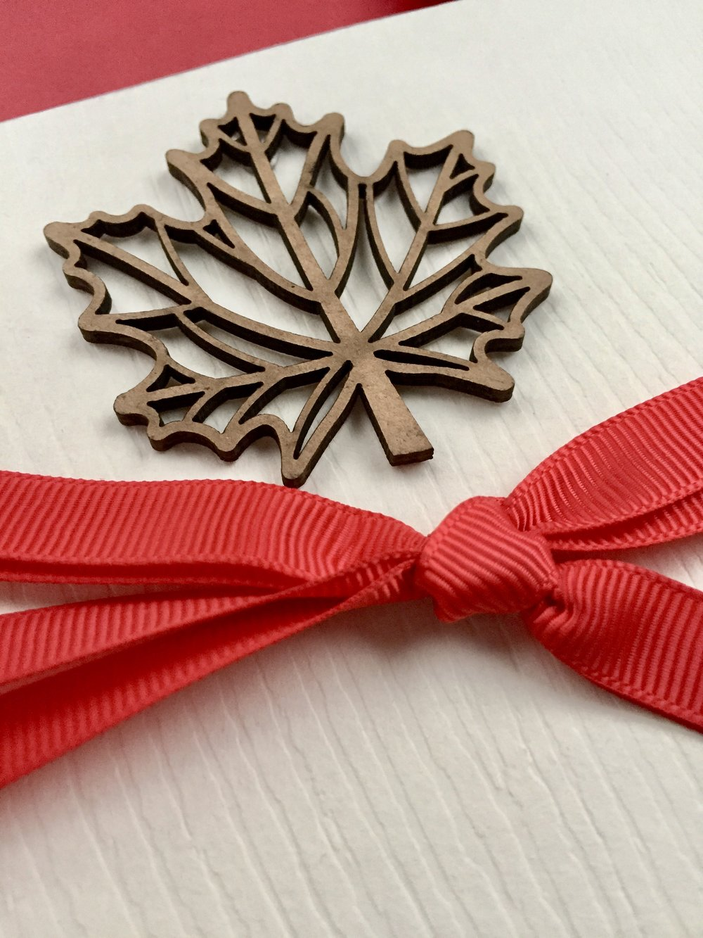 Canadian-themed business gifts (detail), wrapped by Corinna vanGerwen