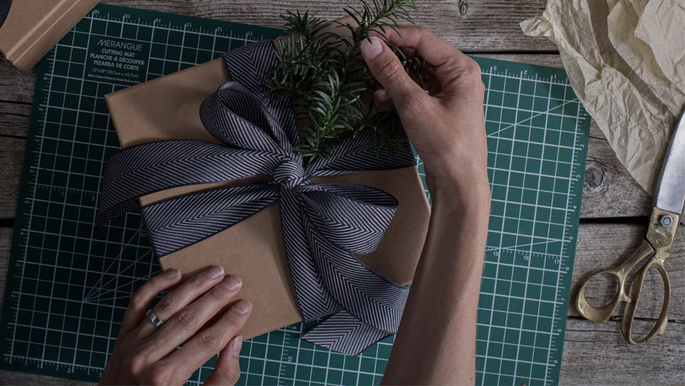 Working With a Gift Stylist - My job as a gift stylist is to minimize the hassle of coordinating a gifting campaign.Finding paper and ribbon. Choosing the best materials from dozens of available options. Placing and receiving orders. Cutting paper and wrapping box after box. I take all of that off your plate, leaving you to serve your clients and do the job you're best at.Here's how the process works for most projects: