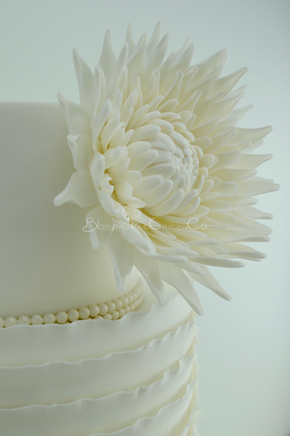 White Ruffle with White Dahlia wedding cake by Blossom Tree Cake Co Harrogate North Yorkshire detail 1.jpg
