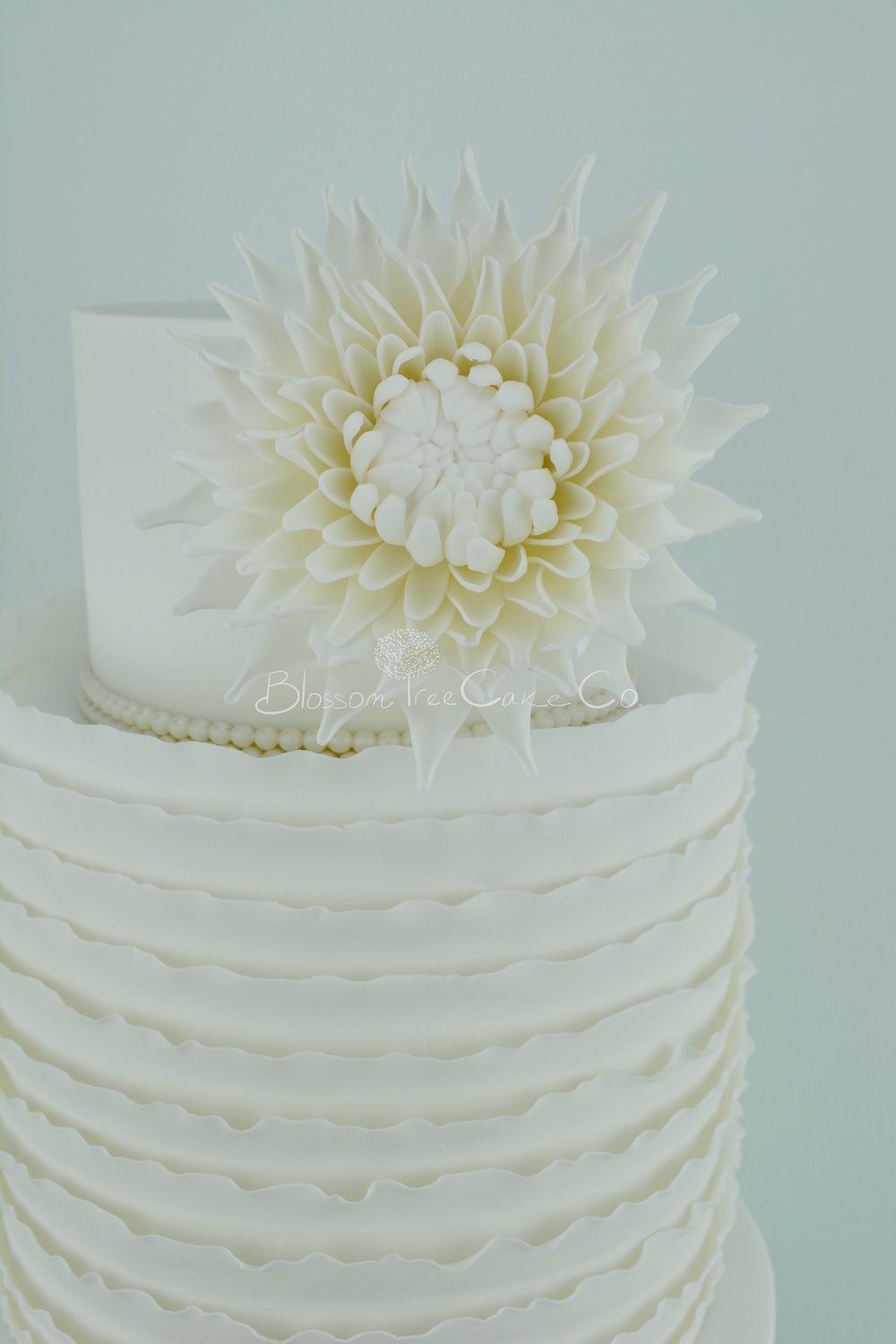 White Ruffle with White Dahlia wedding cake by Blossom Tree Cake Co Harrogate North Yorkshire detail 2.jpg