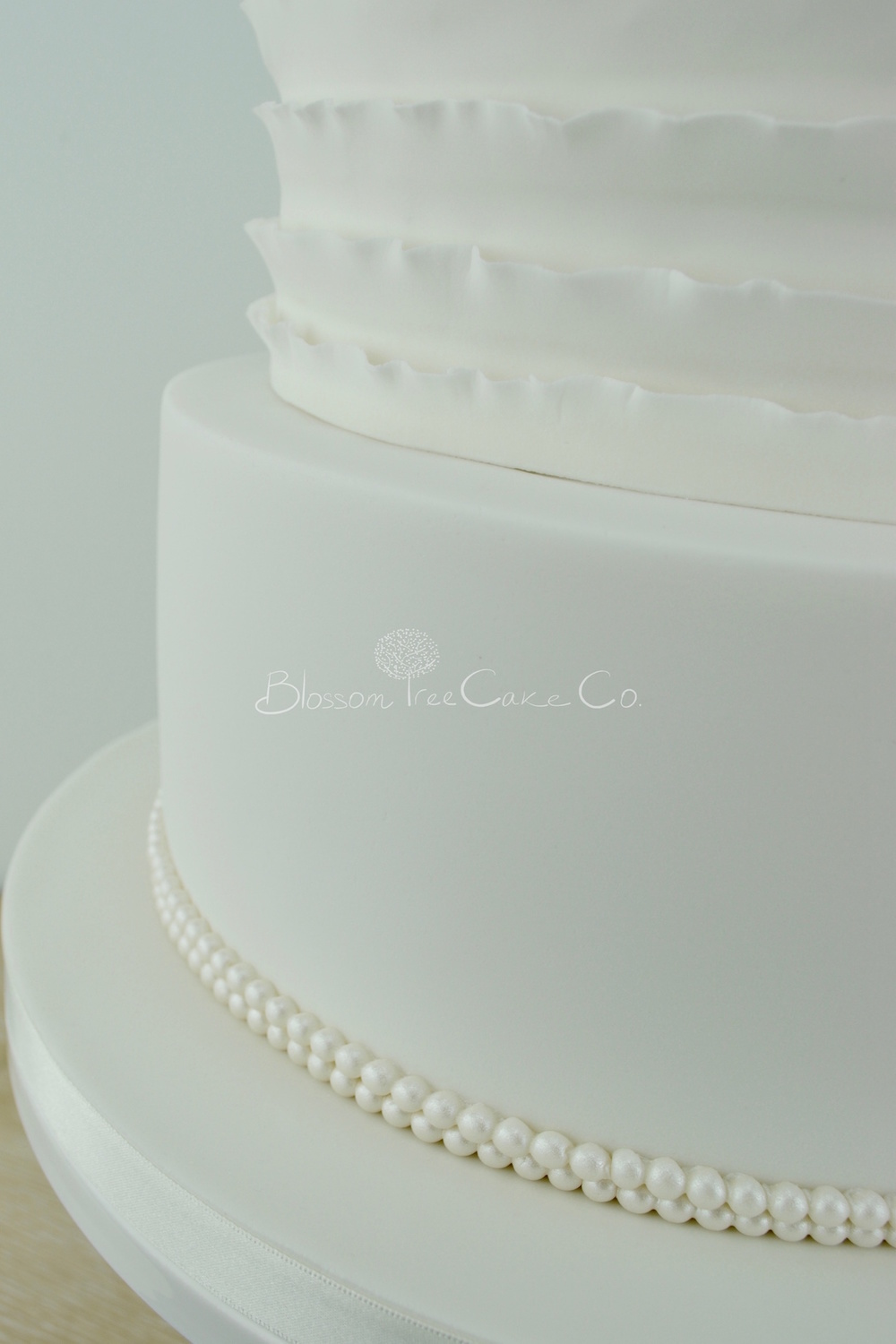 White Ruffle with White Dahlia wedding cake by Blossom Tree Cake Co Harrogate North Yorkshire detail 3.jpg