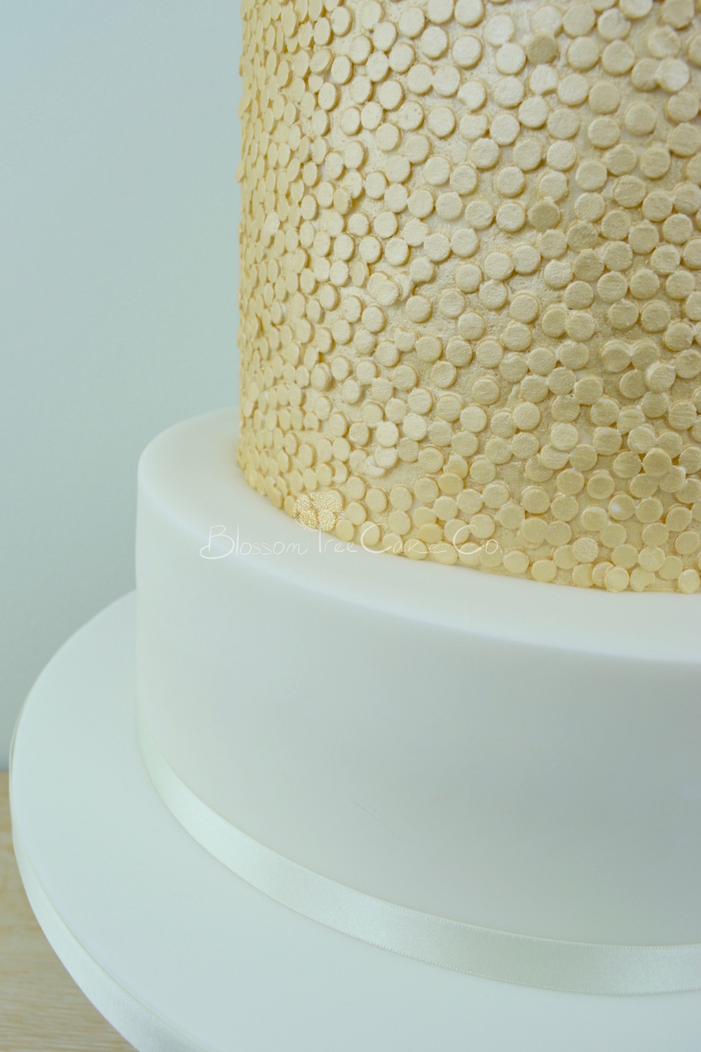 Ranunculus with Gold Sequins wedding cake by Blossom Tree Cake Company