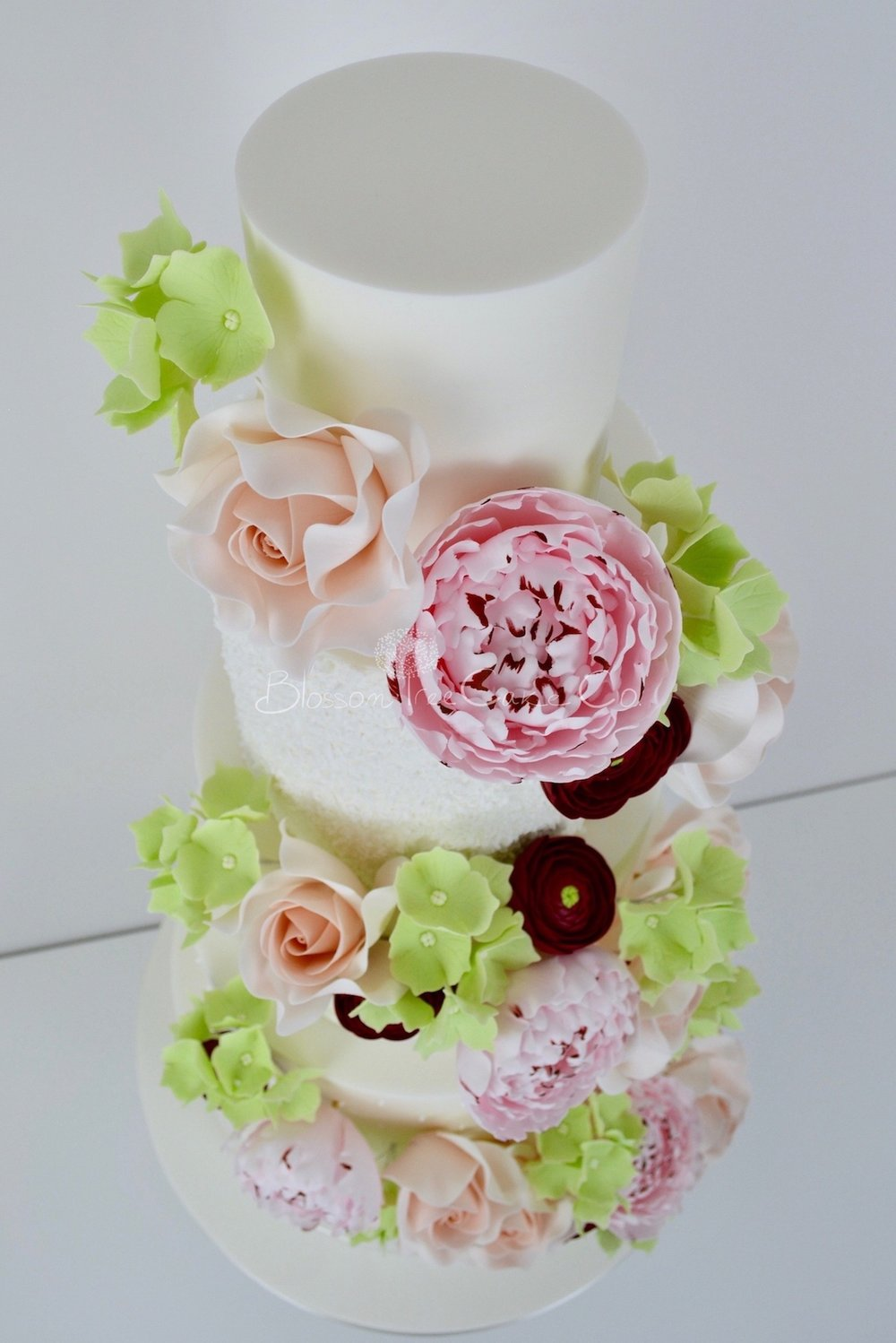 Floral Cascade wedding cake by Blossom Tree Cake Company
