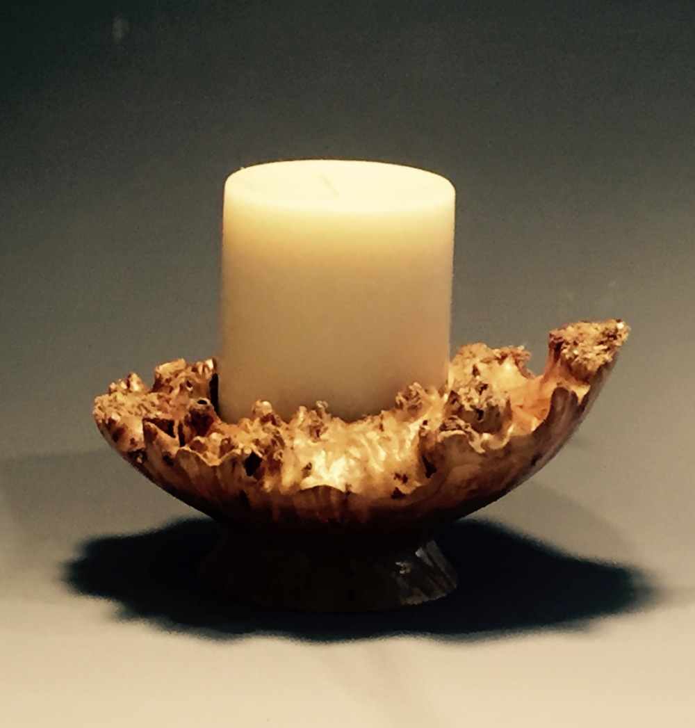 Maple natural edge candle holder.