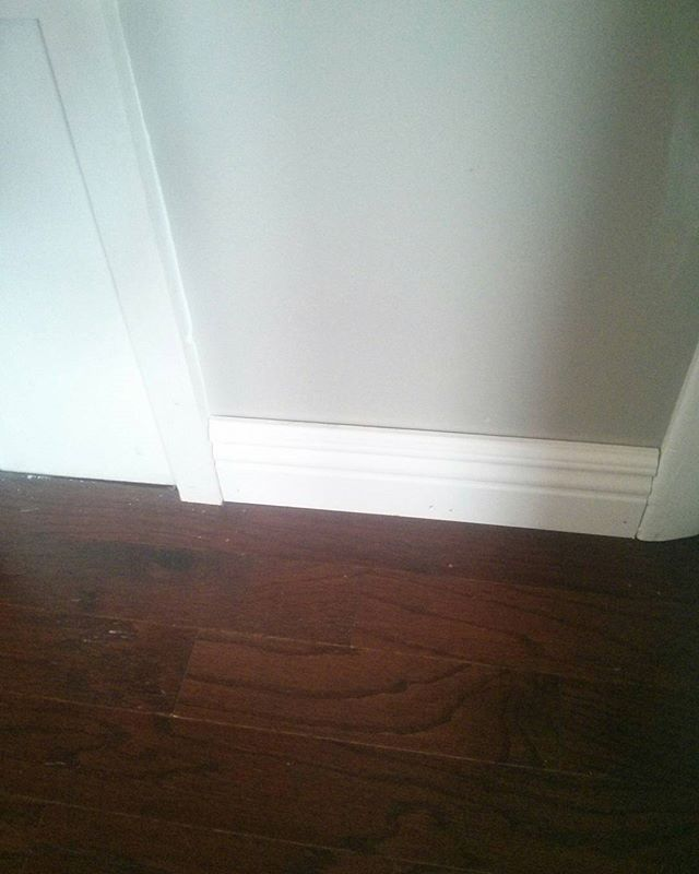 Dark floors , greige walls, white trim. Love how classic it looks! #greige #paint #hardwoodfloors