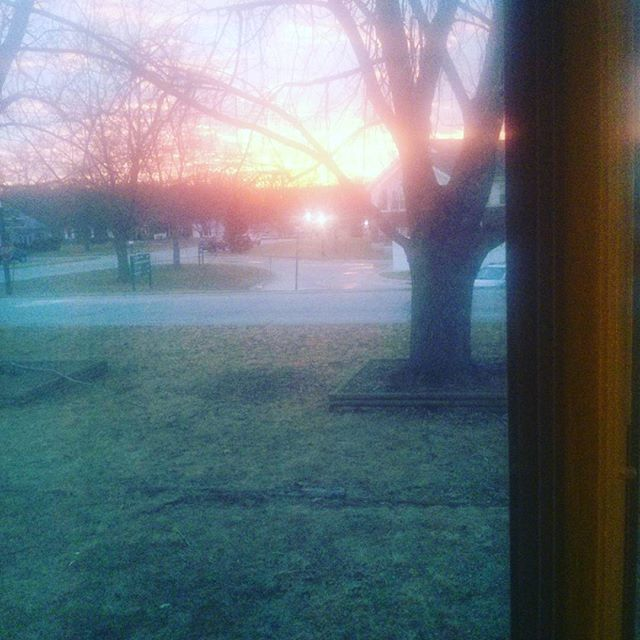 The sky was on fire tonight and it filled our entire living room #sunset #beauty #hugewindows #friday