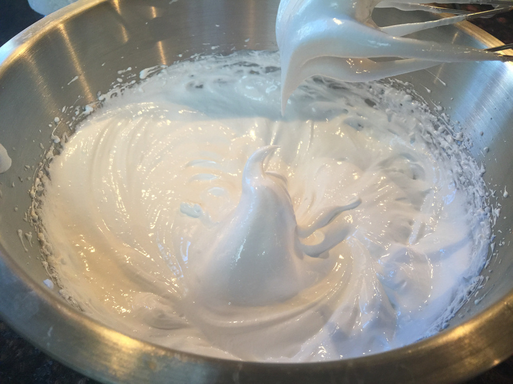 Egg whites and sugar whipped to stiff peaks