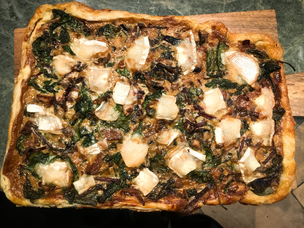 This is Alison's savory appetizer tart, before it was sliced into pieces. Doesn't it look *fantastic*? It was!