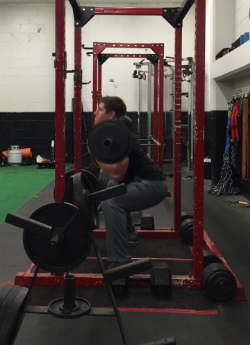Demetri working on his squatting technique with a safety-squat bar.