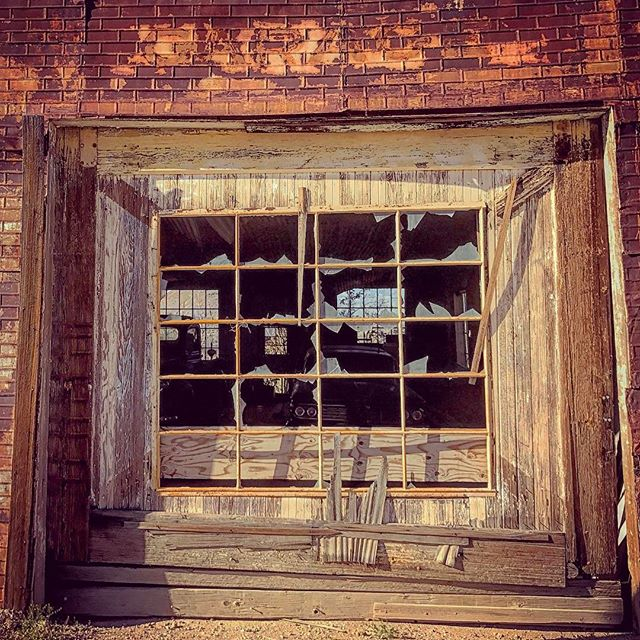 Dare to pull over and look in the broken windows ... #nevada #goldfieldnv #ghosttowns #beyondvegas #wildwest #antique #vintage #signofthetimes #roadtrip #theroad #cars #classiccars #garage #buildings #structure #ipulledoverfirthis