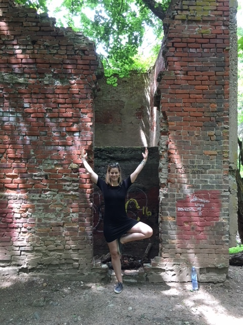 One of my favorite yoga poses by far is tree pose, here in full expression, in front of the ruins of a dairy farm.