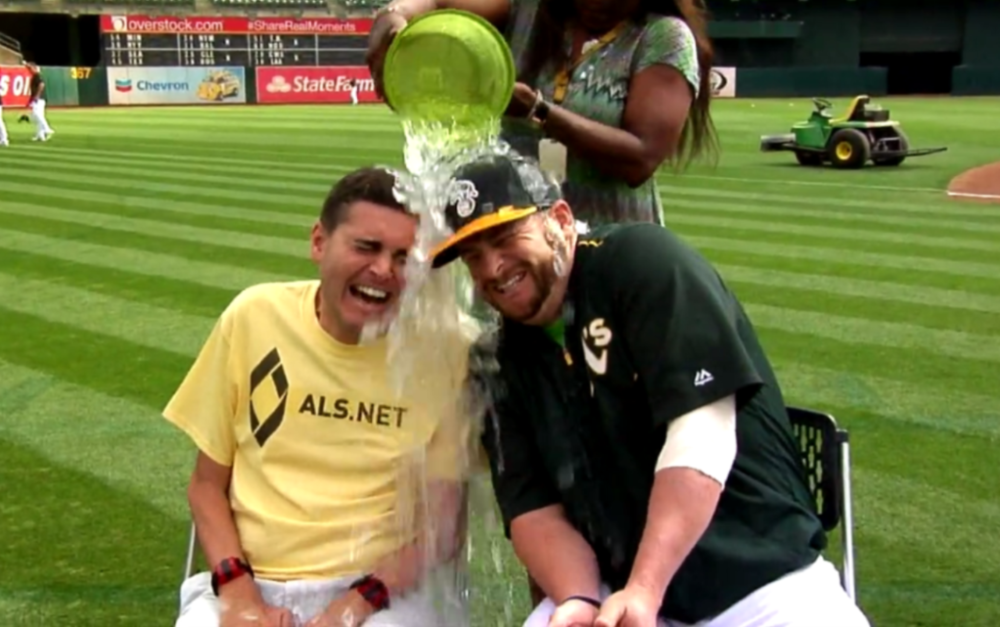 In this screen grab from a video posted on the Oakland A's Facebook page, Corey Reich (left) and catcher Stephen Vogt participate in the ALS Ice Bucket Challenge on August 19, 2015.