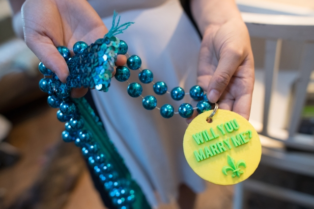 Casey Forster holds the playfully gaudy necklace that her husband, Bobby, gave her when he dropped to one knee and proposed at a Mardi Gras celebration in New Orleans less than two years ago.  Photo: Gretchen Ert/School of Engineering