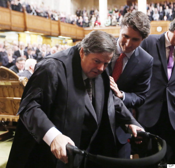 Liberal MP Mauril Belanger is helped by Prime Minister Justin Trudeau as he prepares to leave after he sat in the Speaker's Chair, March 9, 2016.    (Photo: Fred Chartrand/The Canadian Press)