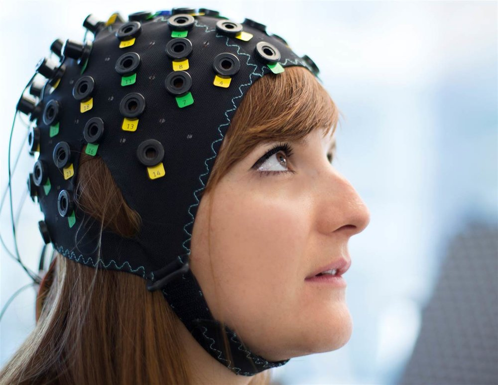 The NIRS/EEG brain-computer interface system is worn by a model in Switzerland on Tuesday.  Laurent Bouvier/Wyss Centre/Reuters