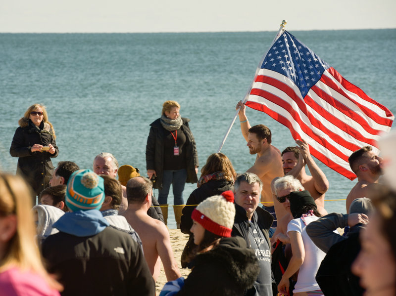 Frank DeSimini, Waldwick, ran around with the American flag as Springsteen's Born in the USA played. The 11th Annual Valentine Plunge Event for ALS was held at the Main Street beach in Manasquan, NJ, Saturday.  Russ DeSantis | NJ Advance Media