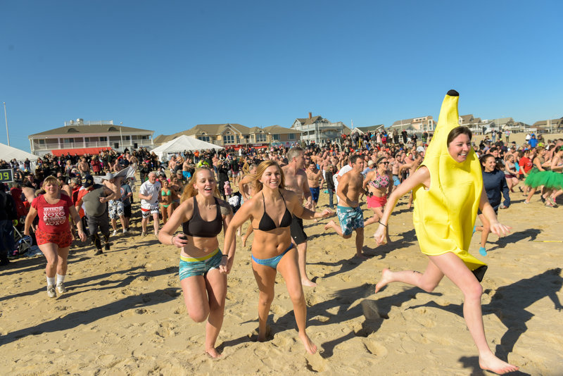 Participants race to the ocean for the start of the plunge. The 11th Annual Valentine Plunge Event for ALS was held at the Main Street beach in Manasquan, NJ, Saturday.  Russ DeSantis | NJ Advance Media