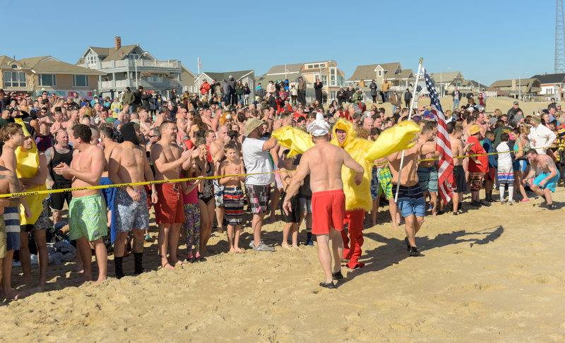 Plungers line up at the yello tape awaiting the start. The 11th Annual Valentine Plunge Event for ALS was held at the Main Street beach in Manasquan, NJ, Saturday.  Russ DeSantis | NJ Advance Media