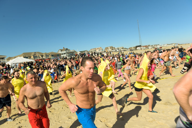 With reckless abandon the plungers make their way to the ocean. The 11th Annual Valentine Plunge Event for ALS was held at the Main Street beach in Manasquan, NJ, Saturday.  Russ DeSantis | NJ Advance Media