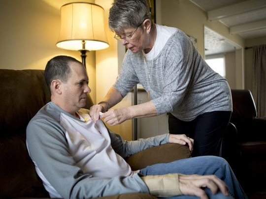 Thu., Feb. 15, 2018: Ann Spears gives her son-in-law, Paul Rinderknecht, a dose of edaravone for the treatment of ALS. Edaravone had been used in Japan since 2015, but was only FDA-approved in May of 2017 -- making it only the second drug on the U.S. market to treat the disease. The first had been approved more than two decades ago. Rinderknecht has become an advocate for federal right-to-try legislation, which would allow terminally ill patients to have access to products that are not yet FDA-approved. ( Photo: The Enquirer/Carrie Cochran )