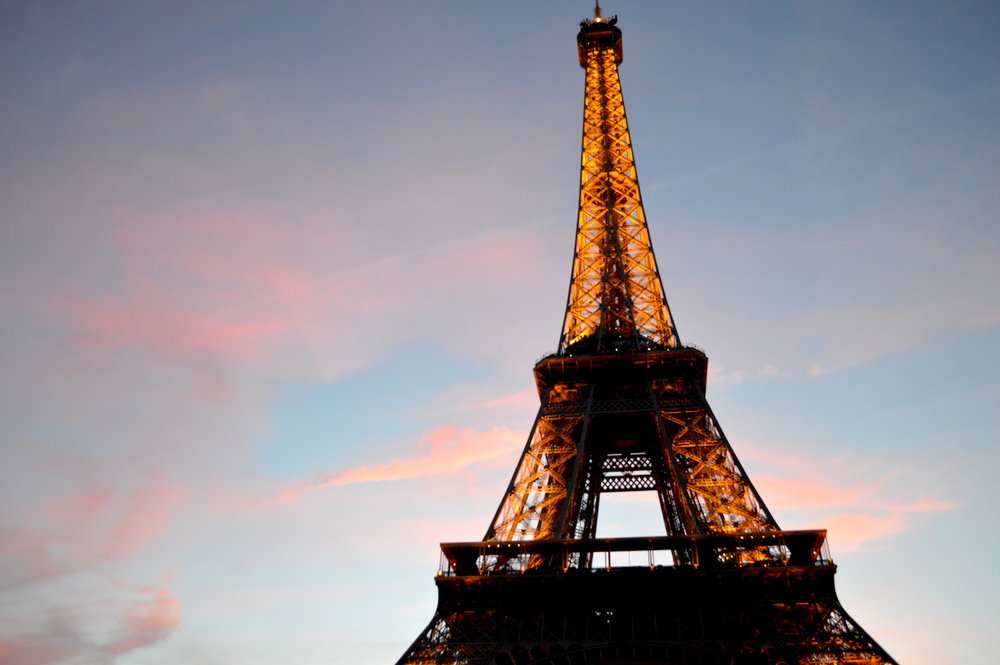 Eiffel Tower at Sunset in Paris, France! // Ever think traveling seems too out of reach? Think again! Debunking four common travel myths - click through and book that next flight. :)