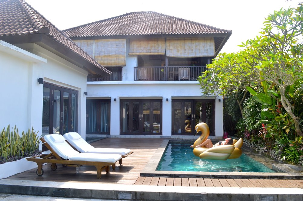 Our villa had three bedrooms, four bathrooms, a kitchen, a private pool, and a balcony overlooking a rice field