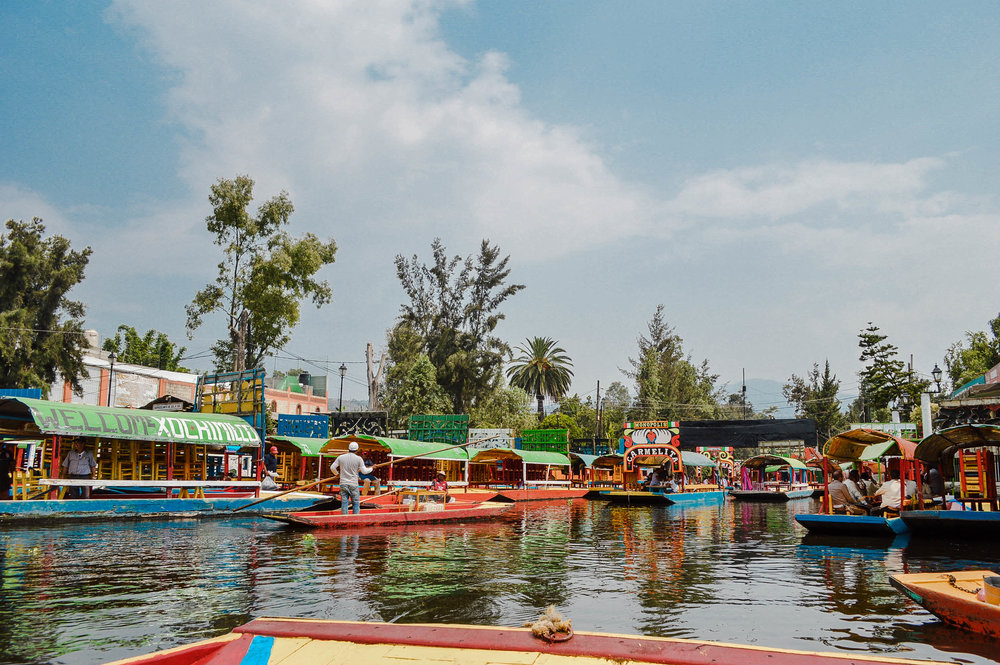 Xochimilco Canals - did you know that in the Mexico City area, you can rent a boat for 1-2 hours and cruise down the water, buy snacks from boats that float up to you, and have a mini party? It was so much fun!