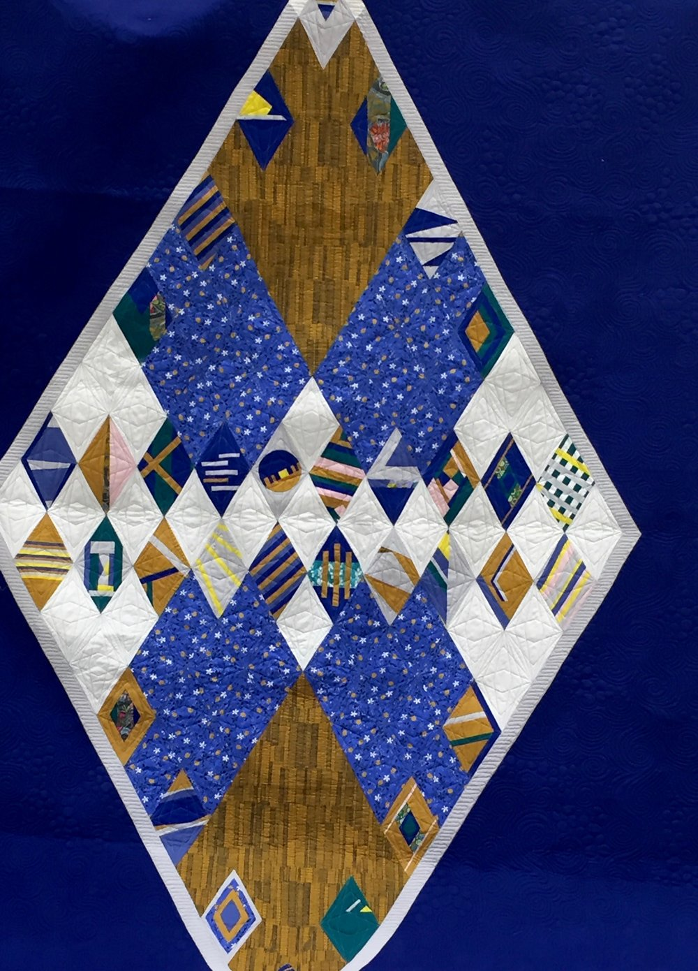 Made to Scale, PMQG's 2017 QuiltCon Charity Quilt, made by AnnMarie Cowley and other PMQG members -- thank you for naming our quilt, January meeting goers!