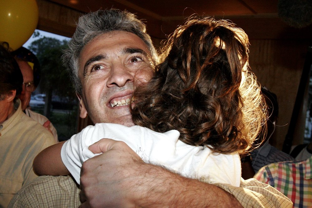 Ibrahim Parlak with daughter Livia, 2005.