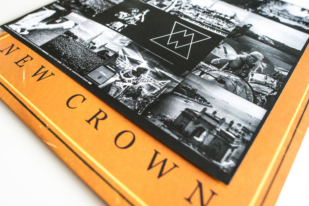 "Wolfmother ""New Crown"" vinyl packaging, photos below and to the right of logo"