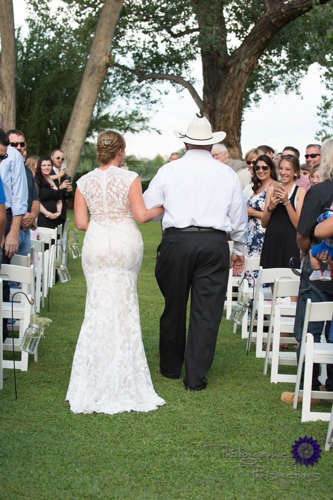 walking down the asile, lace dress, updo bridal hair