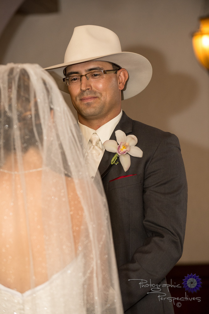 white cowboy hat, cowboy wedding, orchid corsage, view of groom,