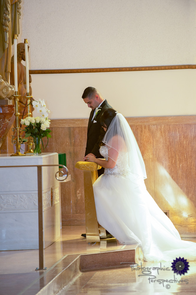 catholic wedding, gold accents, kneeling at the alter